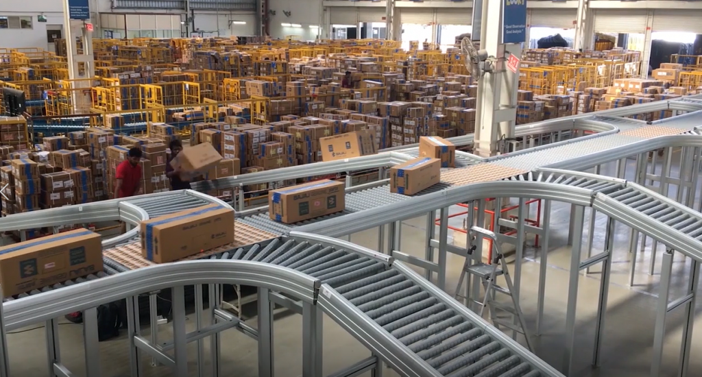 Boxes on a conveyor being sorted to different lanes in a warehouse